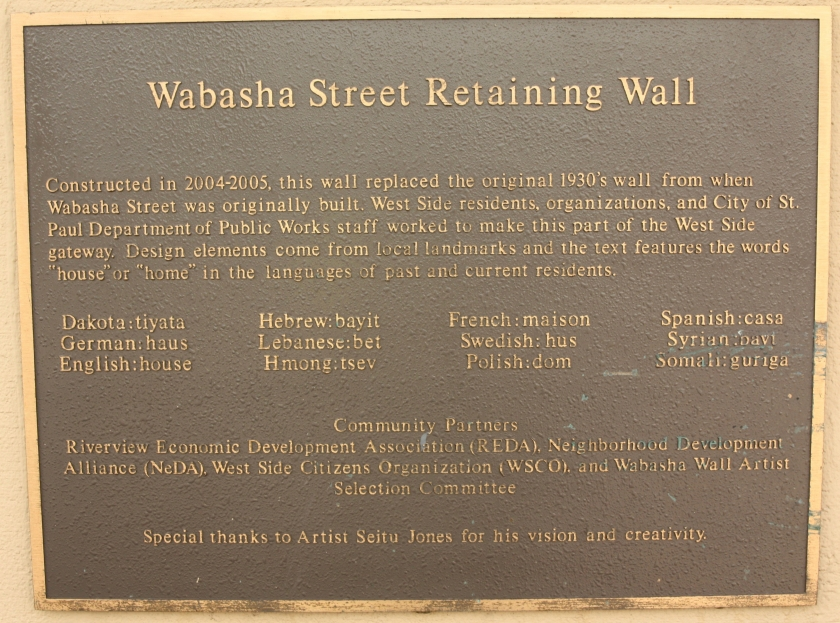 This plaque details the history and design of the Wabasha Street Retaining Wall.