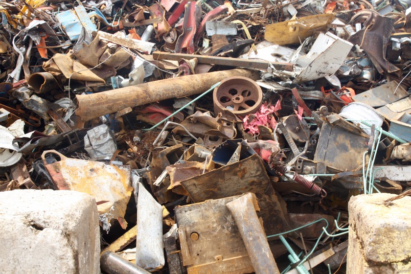 In a nearby pile, awaiting further processing, were pipes, motors, fencing, springs and other larger pieces of scrap.
