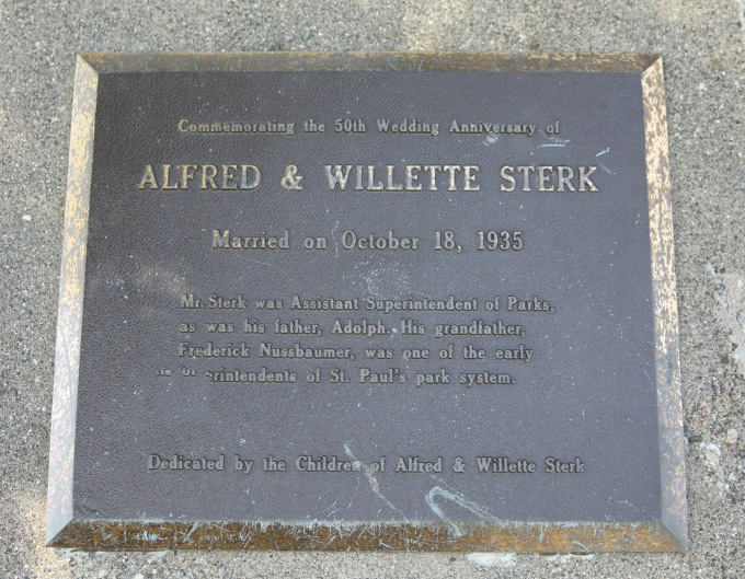 This commemorative plaque is attached to a rock along the walking path that goes past the Como Lakeside Pavilion.