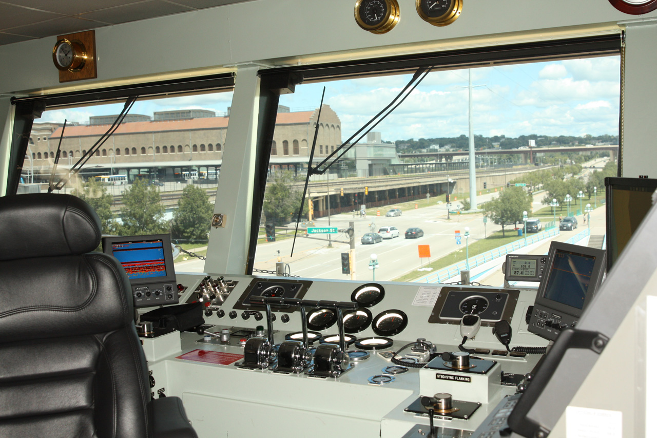 The pilot's station has levers for the three ??? horsepower engines and many other controls and meters the pilot needs to control the boat.