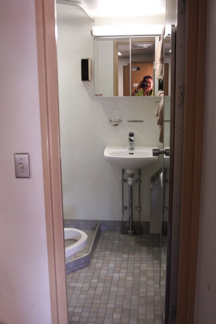 Adorned with just the necessities, a bathroom aboard the vessel varies little from many public restrooms.