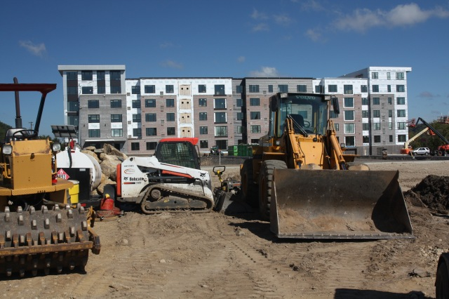Construction equipment was parked in a way to reduce the chance the Bobcat or trailer with the white tank would be stolen. The V2 Apartments are in the background.