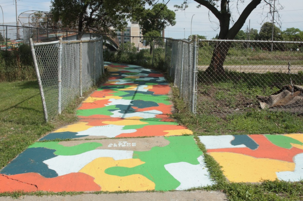 The sidewalk mural along Concordia Avenue leading to the Aldine Bridge over I-94.