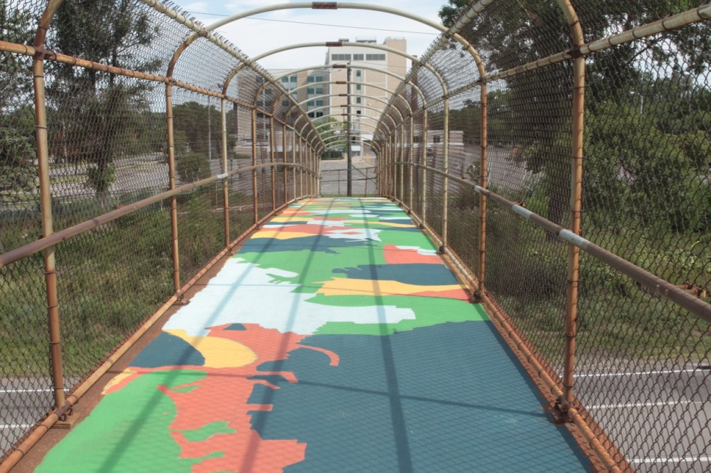 "The mural continued on the Aldine Bridge deck. On her artist page, Hoisington described the mural design coming from ""drawing continuous lines, outlining and connecting shapes and textures visible from the bridge…"""