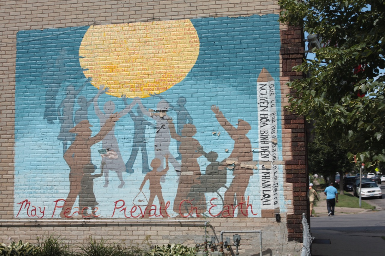 The peace mural on the back of Willard's Liquors.