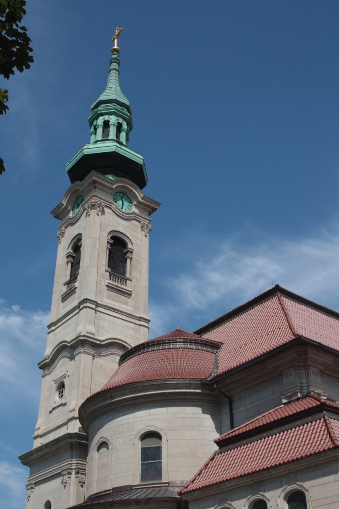 The bell tower and part of the sanctuary structure as seen from Thomas Avenue, just east of the church.