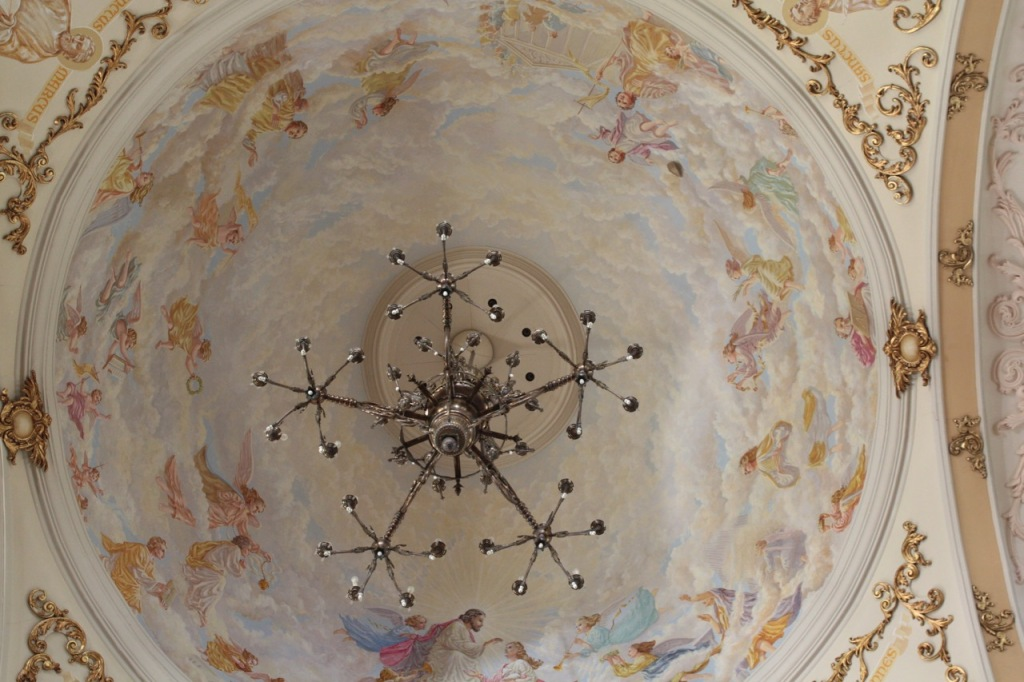 The dome of the chapel is 60 feet above the floor. The exquisitely painted mural, according to the St. Agnes website, portrays Christ crowning Agnes of Rome as a saint. Angels and saints of Rome surround St. Agnes.