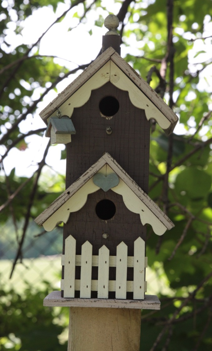 The intricate birdhouse was in the best condition of the items in the sanctuary.
