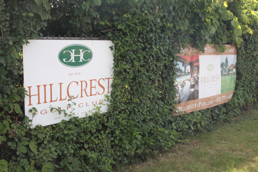 The fence along Larpenteur restricting access to HIllcrest doubled as a billboard for the golf club.