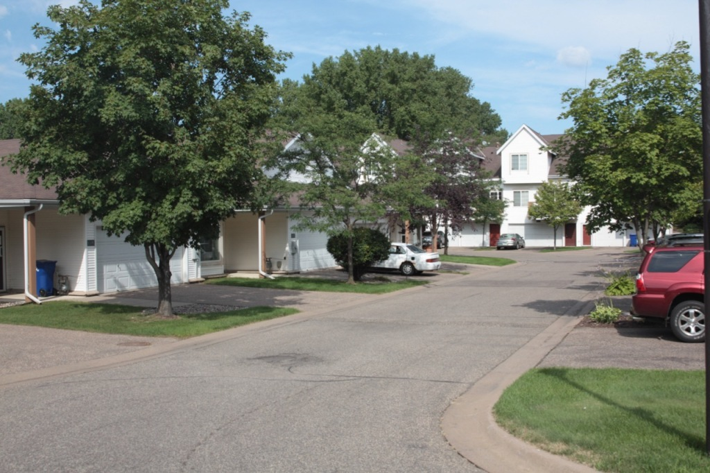 The Lake Phalen Townhomes' private roads, driveways and garages at hidden in back.