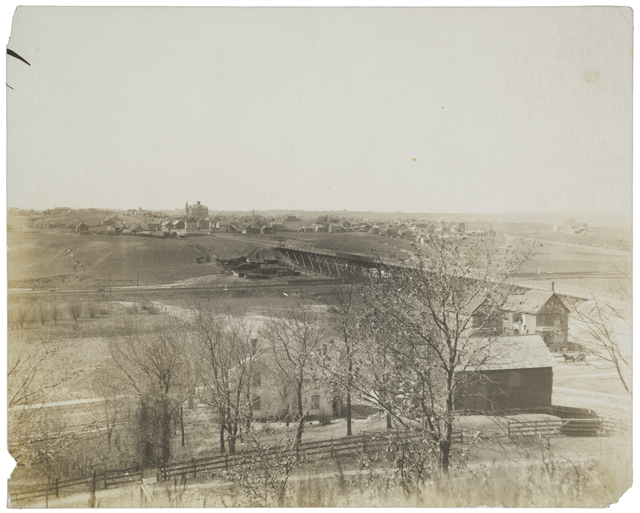 The the Jessamine Street Bridge carried vehicles over the valley and railroad tracks. This picture is from about 1906. Courtesy Minnesota Historical Society