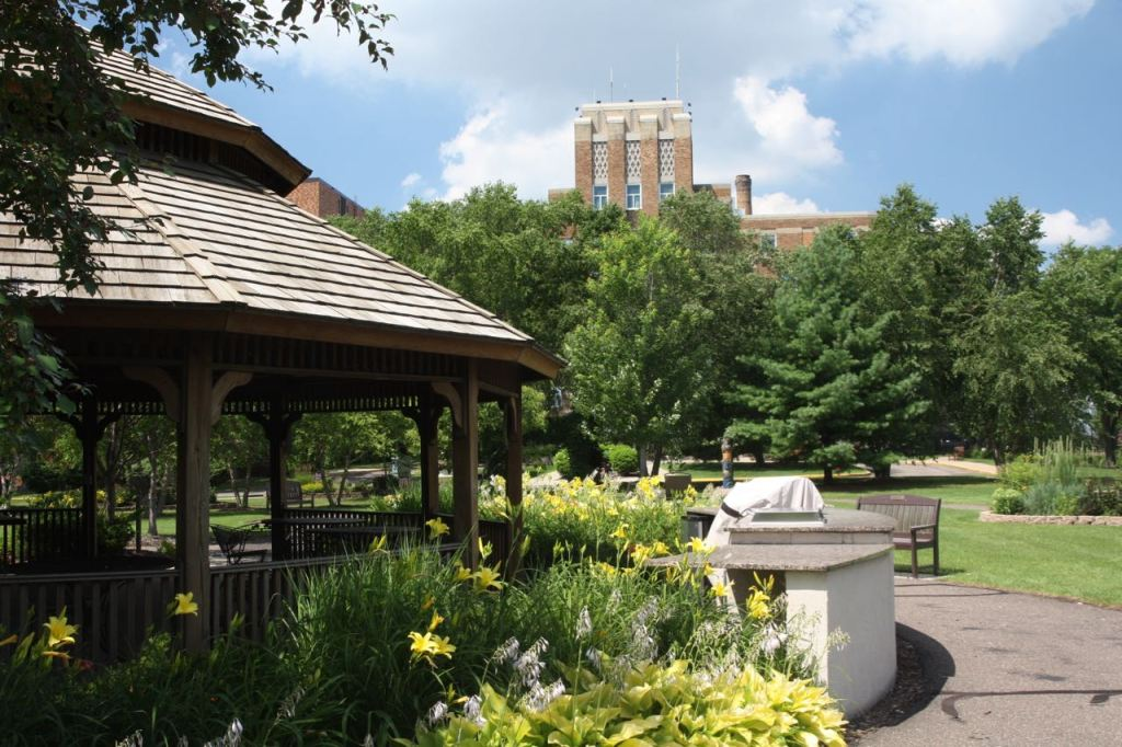 The gazebo and flower gardens and the Wold wing of the hospital in the background.