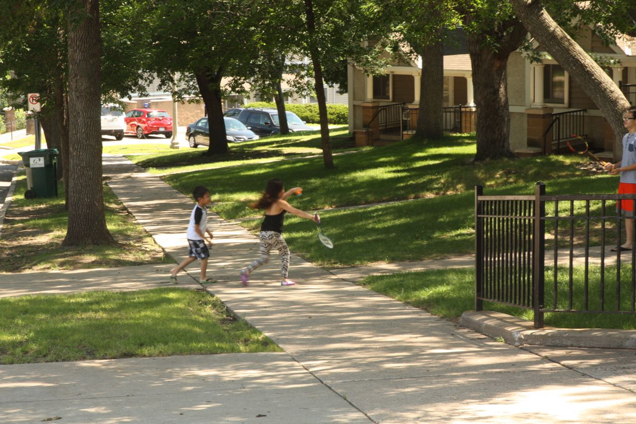 Children enjoy the nice weather on Mount Airy Street.