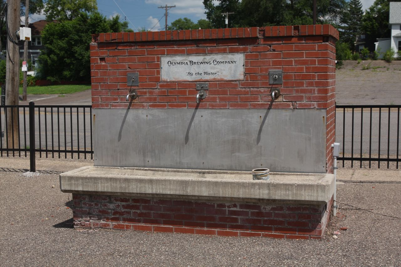 Under Olympia's ownership, water from the same spring used for brewing flowed to a public tap (or the sign above the tap was changed to reflect Olympia's ownership. Spring water once poured from this tap in the parking lot adjacent to Stroh Drive.