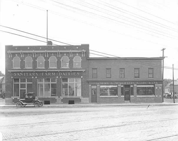 The Sanitary Farm Dairies, left, and the Farmers and Merchants State Bank buildings around 1919. Courtesy Minnesota Historical Society