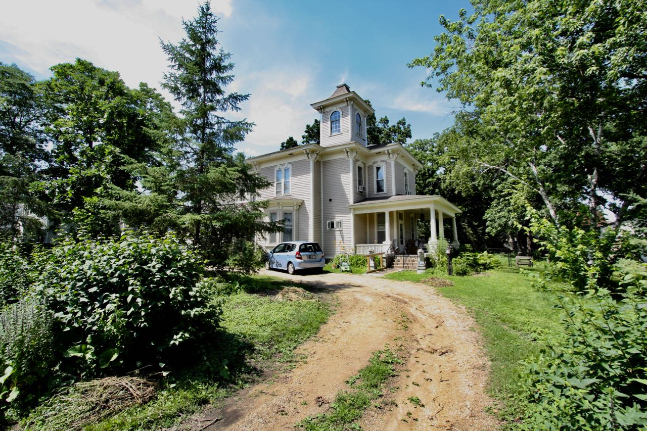 The Victorian home and its gravel driveway and large lot at 1371 Nebraska Avenue.
