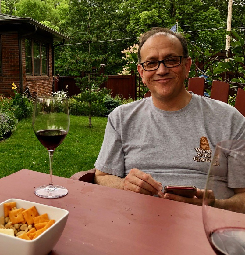 Gary Epperley enjoys a glass of wine in the yard he and Marcus meticulously attend to. Photo courtesy Marcus Phelps-Munson