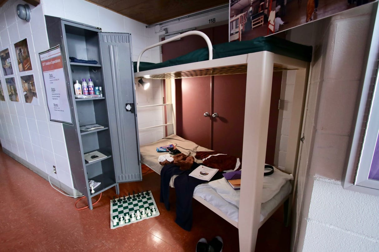 An example of a dorm room, including a locker, games, bunk bed with a book on Totem Town's behavior expectations, and clothing, was set up on the main floor.