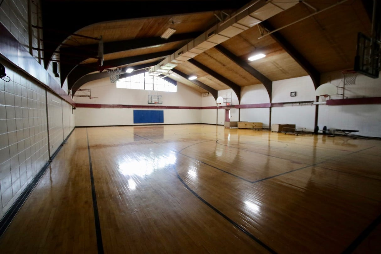 The gymnasium, nearly void of equipment.