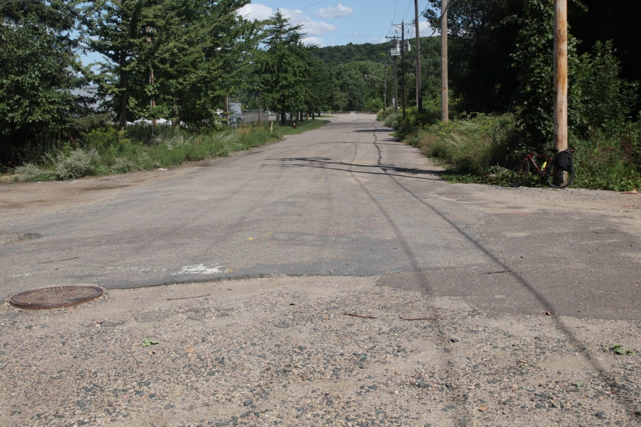 Just west, this section of James Avenue doesn't end as much as it gives up. The view is east toward Randolph Avenue.
