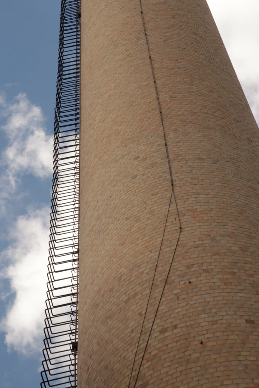 The smokestack and its dizzying number of rungs that go to the top.