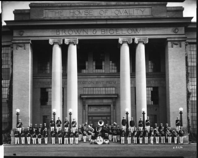 The Brown & Bigelow Band poses in front of the University Avenue headquarters in 1924.