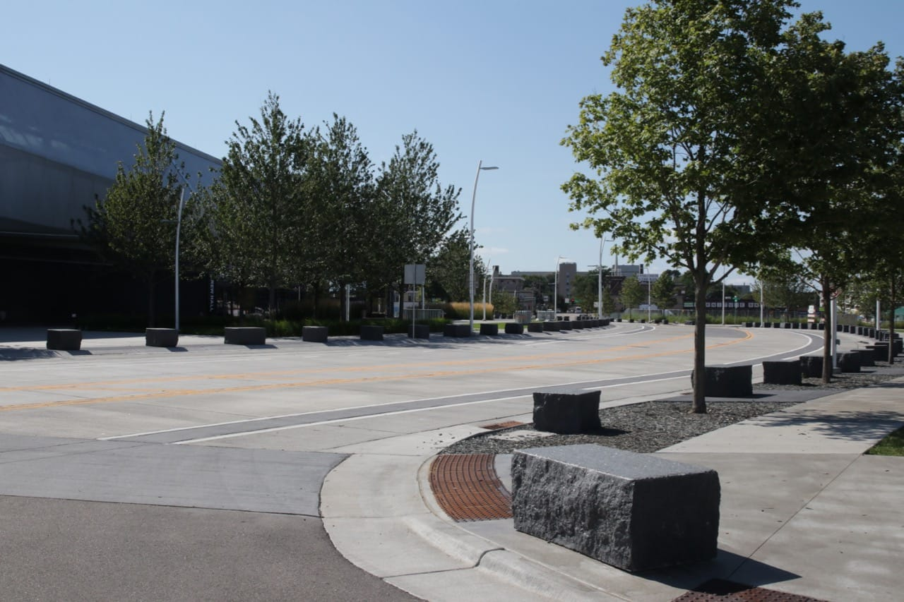Shields Avenue mirrors the arc of the stadium's exterior. The blocks of rock are benches but also keep errant vehicles from straying from the road.