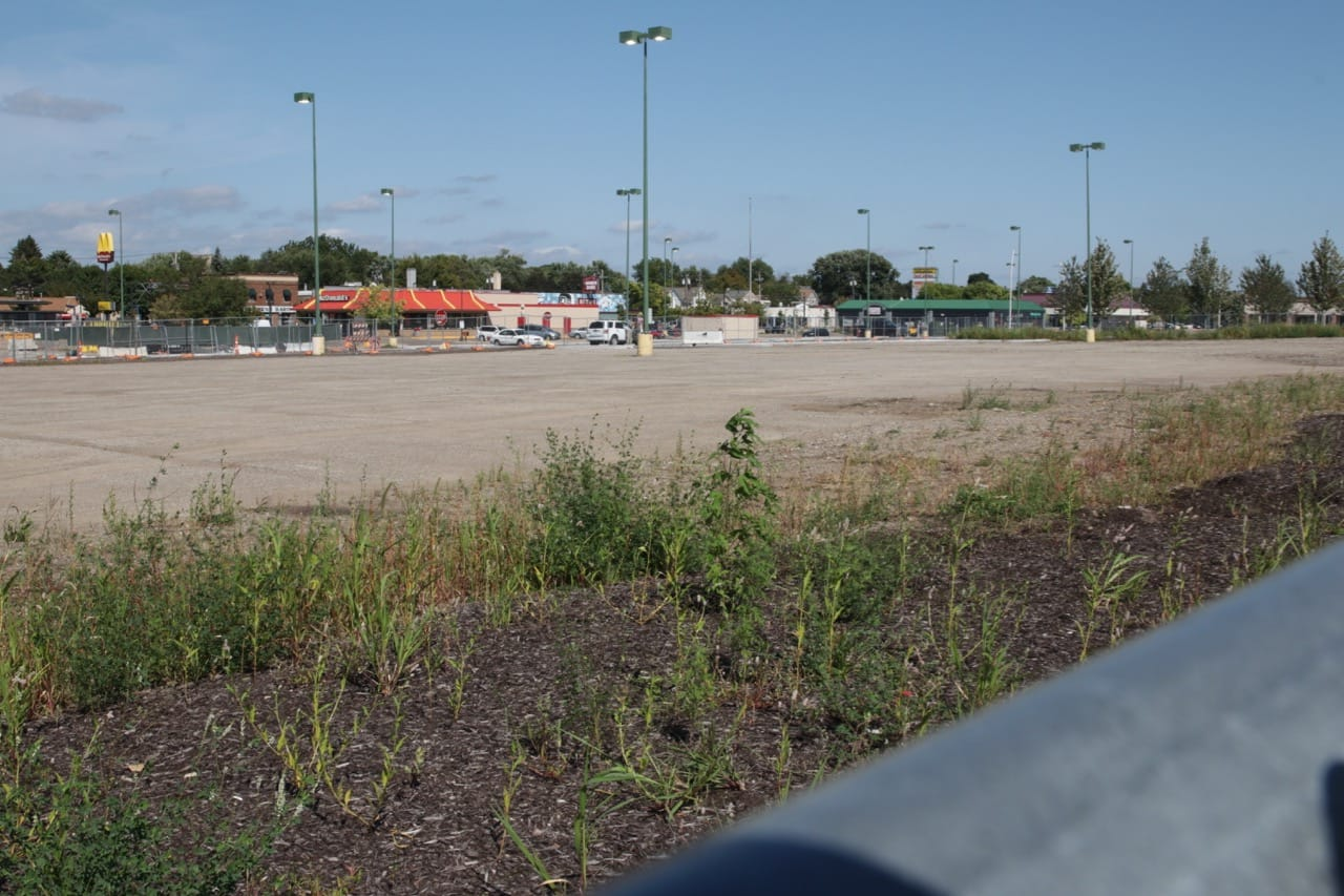 The northwest quadrant of the former Midway Center property remains effectively untouched. The parcel is along University, Snelling and Shields Avenues was surrounded by a fence, Even the old parking lot lights remained.