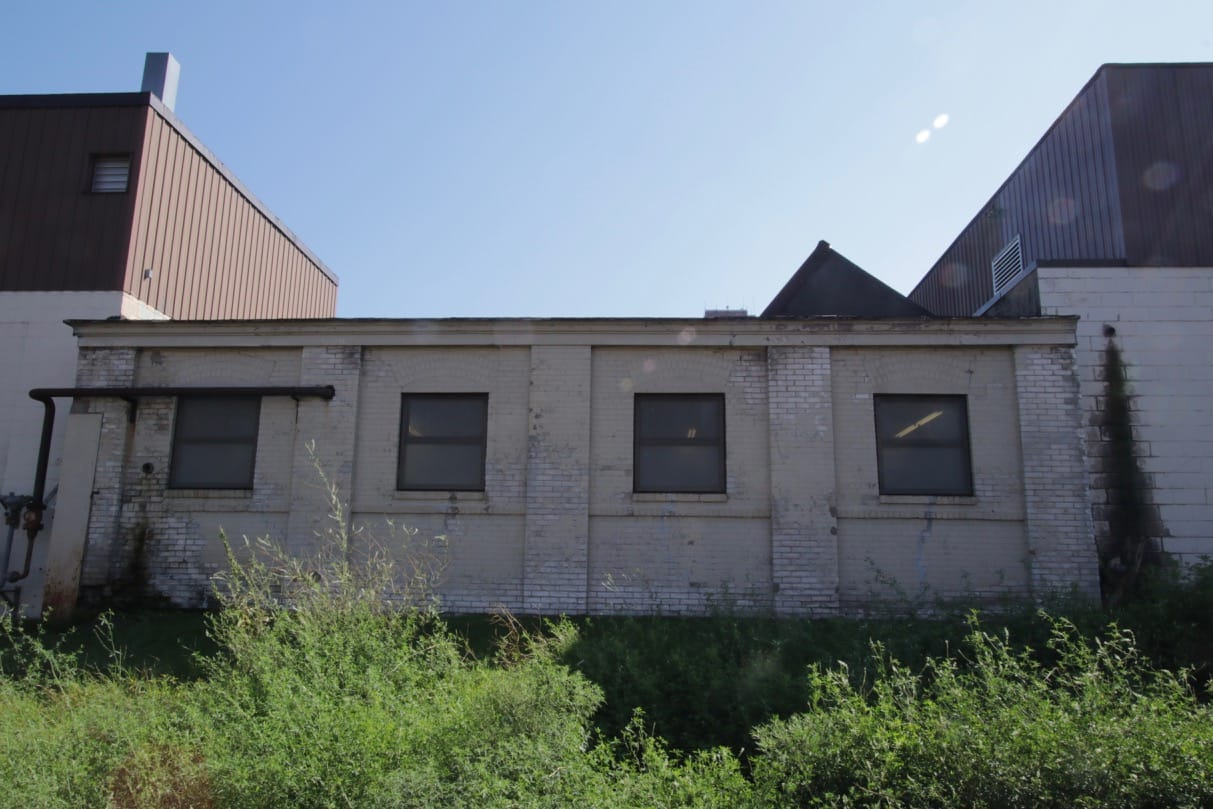 In reality, Rayven Inc. occupies several connected buildings, including this obviously older one.