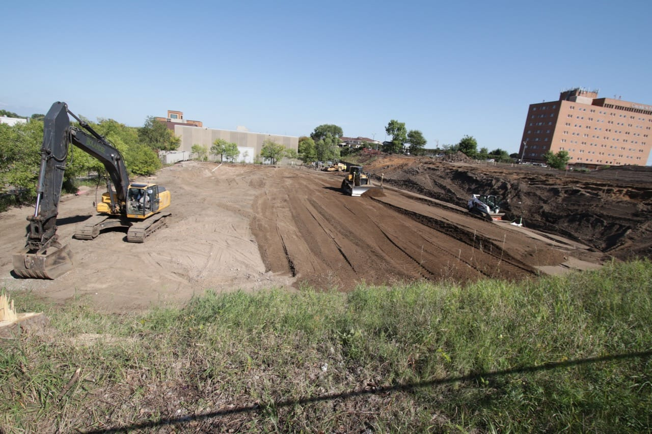 The heavy equipment began converting old parking lots into Midway Peace Park. The much needed new park is slated to open in summer 2020.