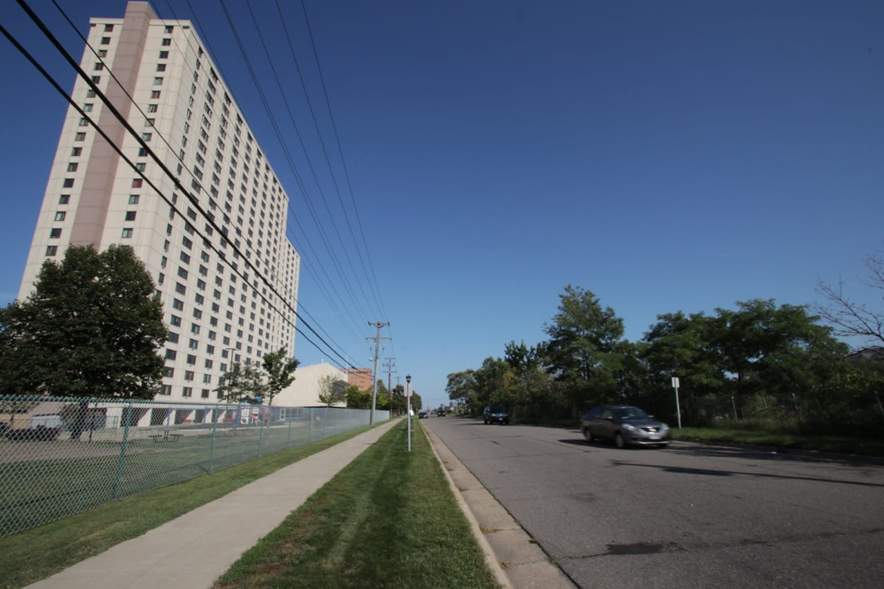 A car passes Skyline Tower on St. Anthony Avenue.