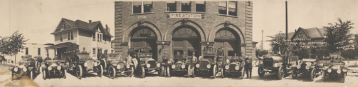 Early motorized fire trucks parked in front of Station 18 for this photo taken in 1918. Photo by Randolph R. Johnston; Courtesy Minnesota Historical Society.