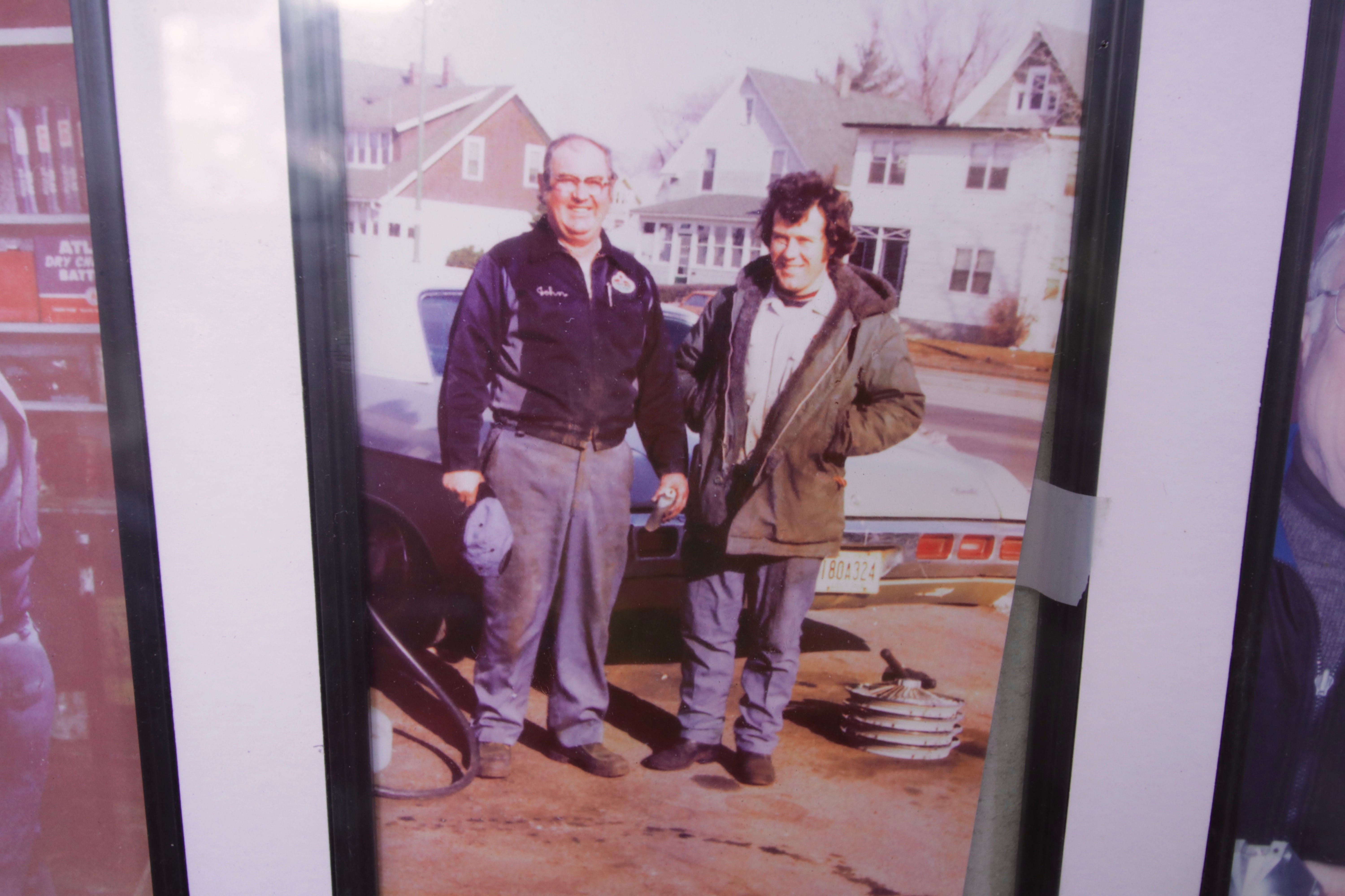 This photo of Mike Glasgow and his dad, taken in the '70s, hangs on the wall of the office.