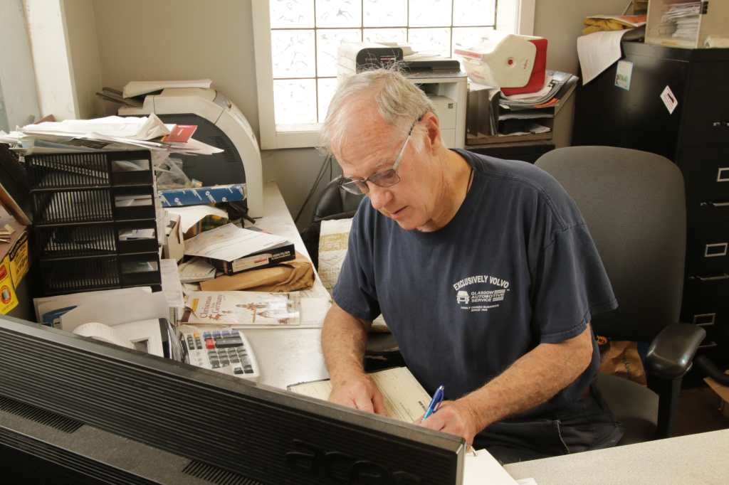 Mike Glasgow finishes some paperwork at his desk.