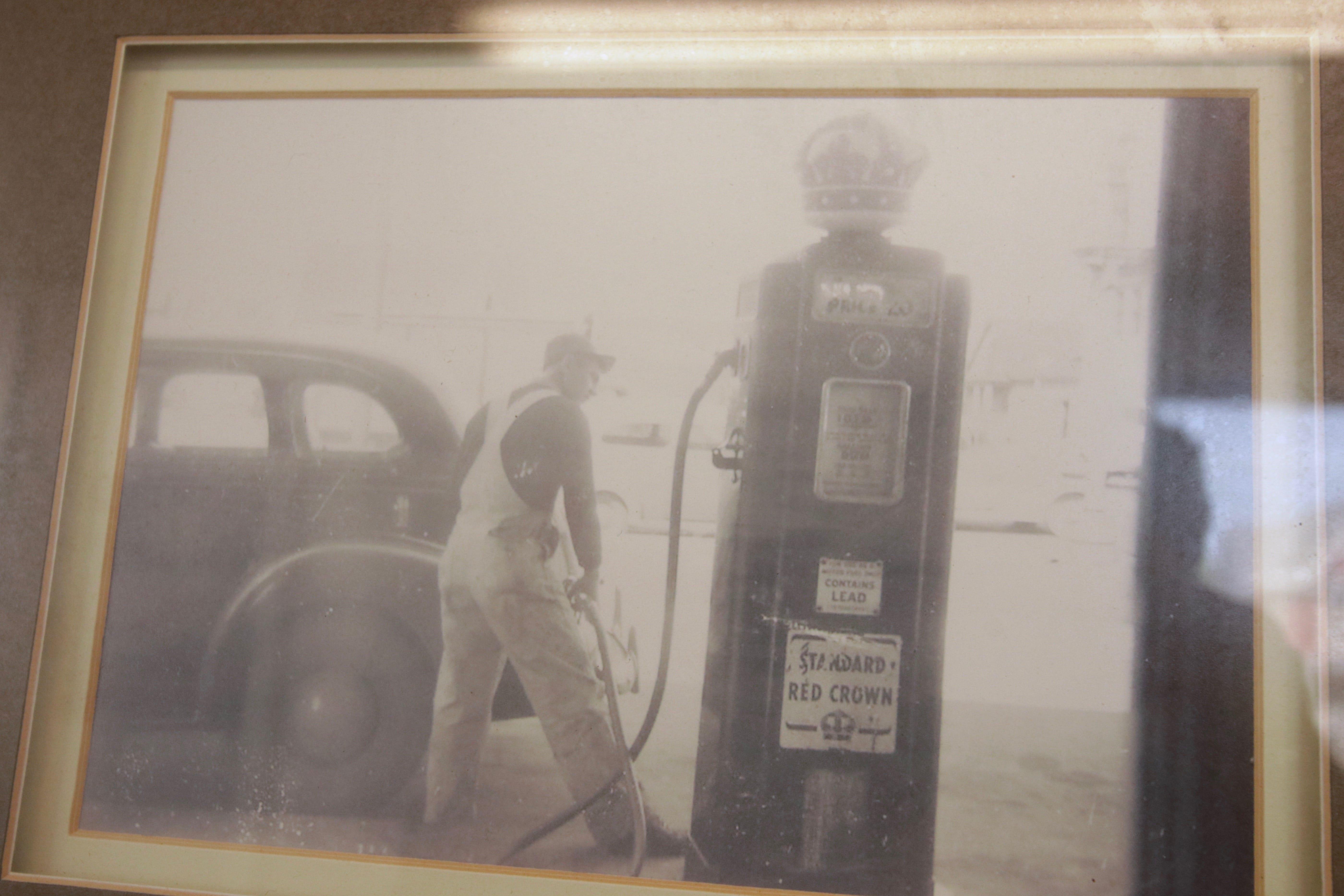 John Glasgow pumped Standard Oil Red Crown gas into a car.