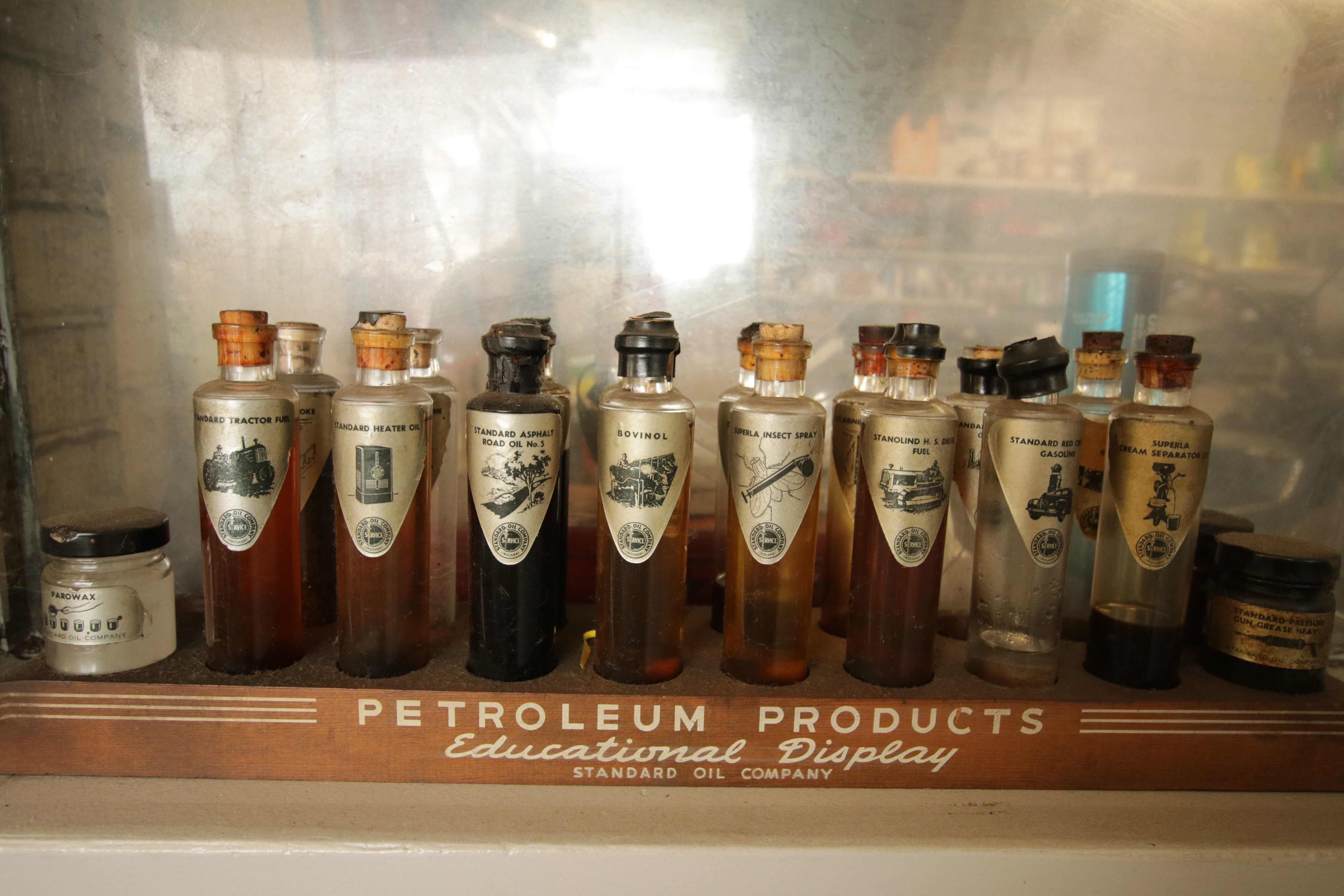 The Standard Oil Company Educational Display of Petroleum Products in the office likely is from the '40s.