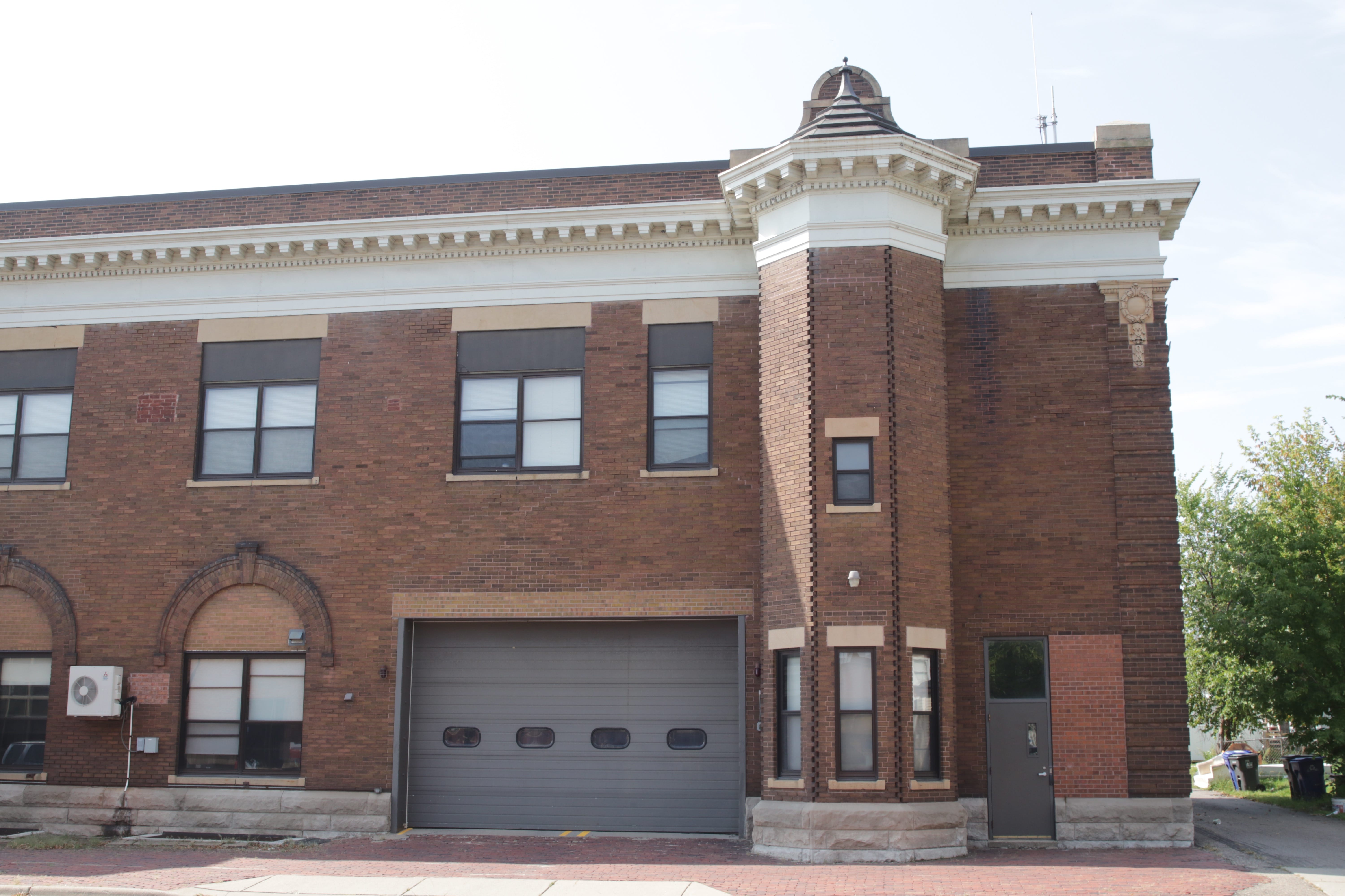 Some of the updates to the fire house are noticeable on the east side. The large garage door was added years after the station opened and lovely arched windows were replaced by more standard rectangular ones.