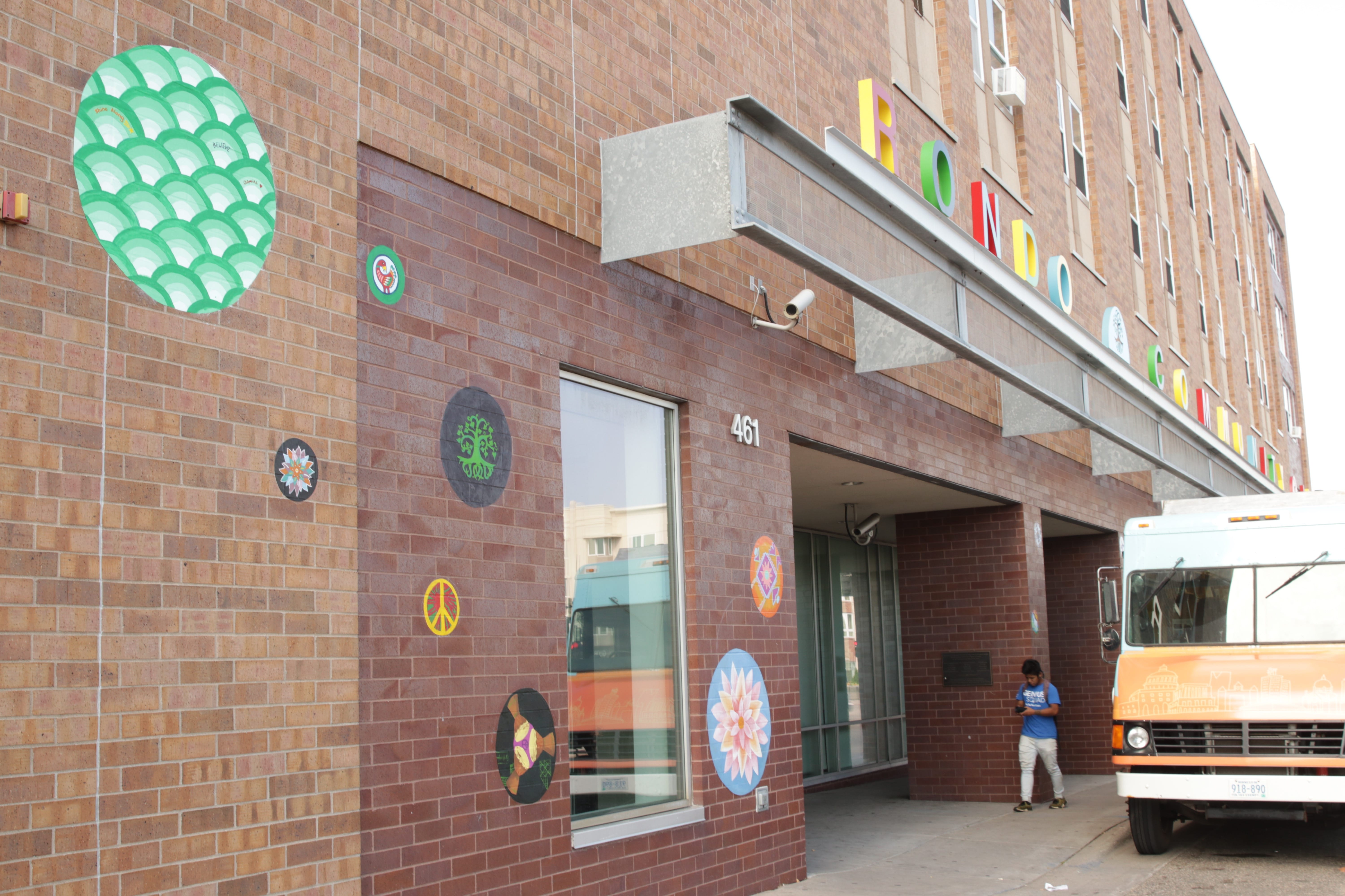 Andres had previously attached circles of assorted sizes and designs to the east wall of Rondo Library along Dale Street.