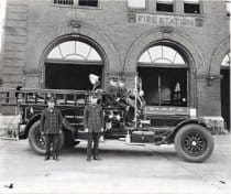 Firemen stand in front of their rig circa 1930. Courtesy Minnesota Historical Society.